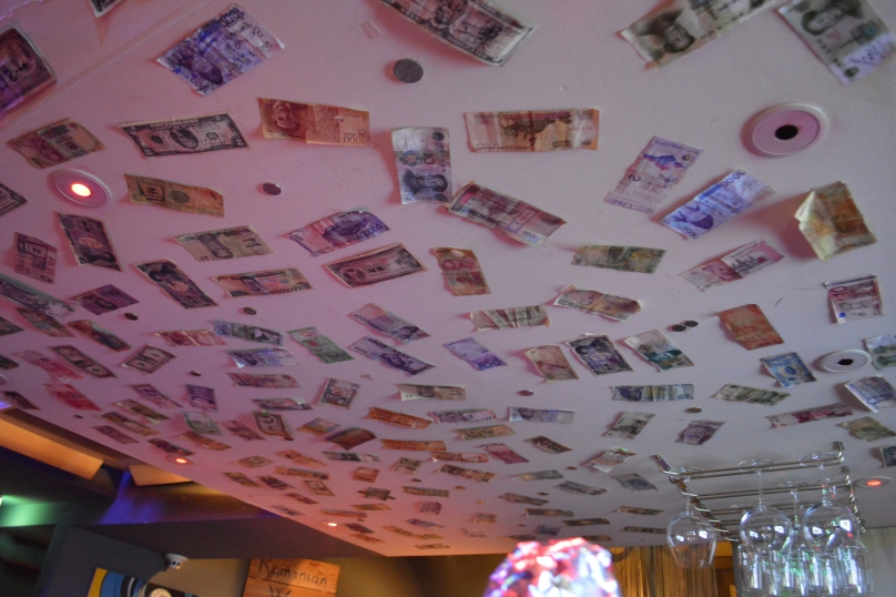 Money glued to the ceiling in the Romanian bar