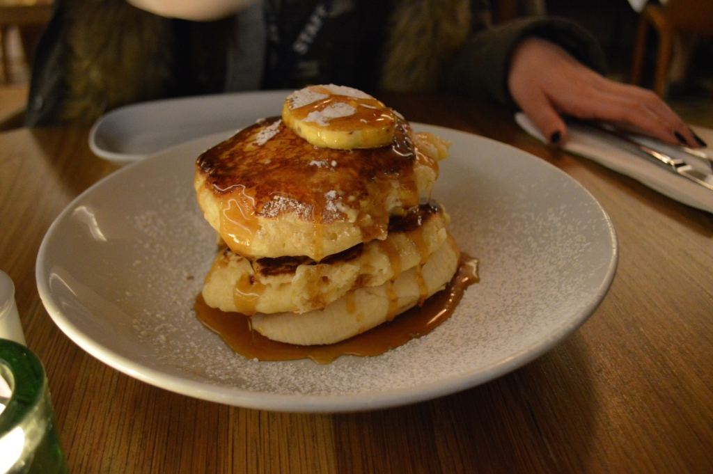 Ricotta pancakes with maple syrup liberally poured over