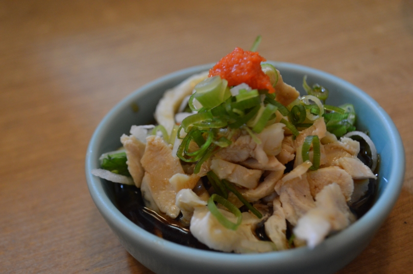 The first of our complimentary dishes- chicken served cool in soy sauce, garnished with shallots and mentaiko
