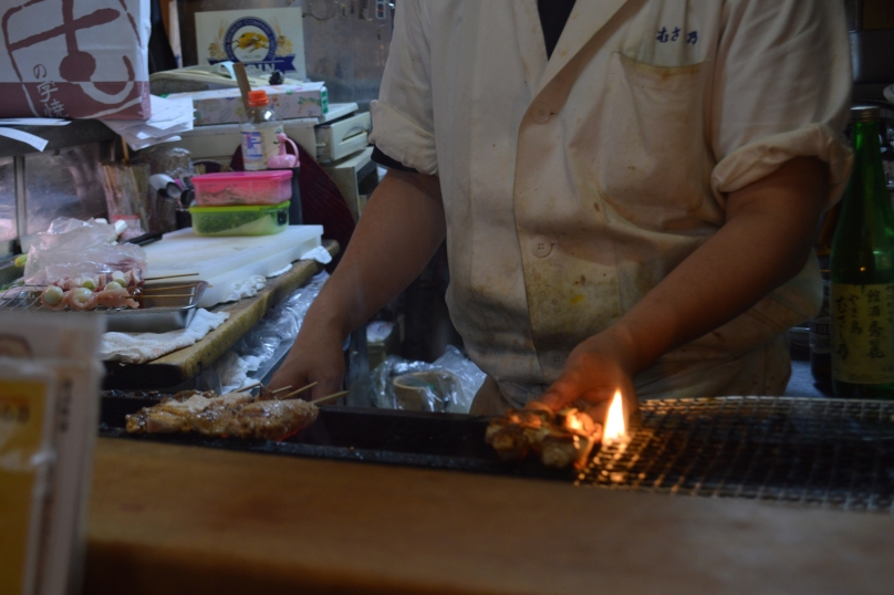 Yakitori skewers being grilled