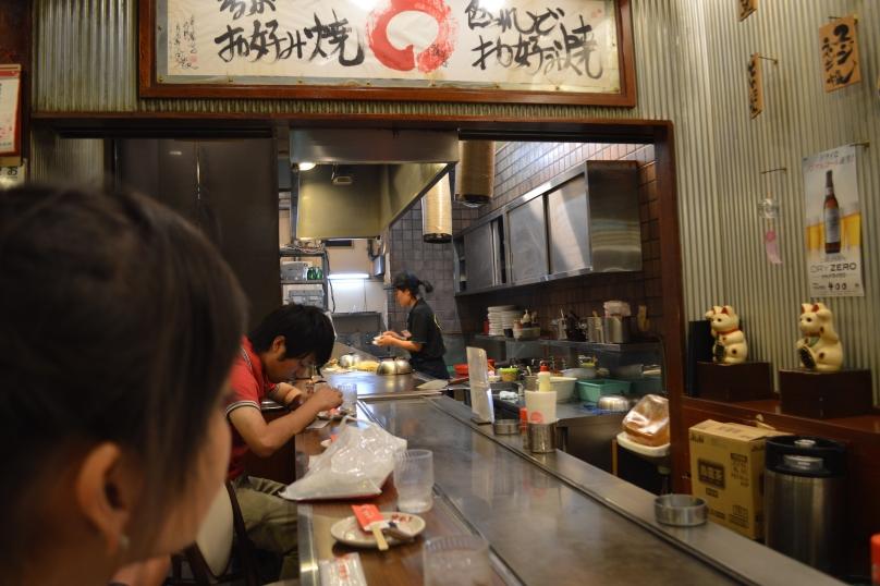 Chef preparing the okonomiyaki batter in the open kitchen