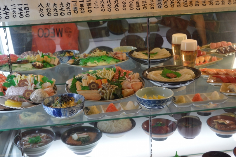 Plastic food on display at the front of the udon restaurant