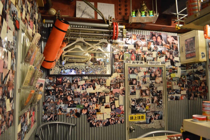 Walls of the soft serve shop decorated with pictures- not an unusual form of decor in Japan
