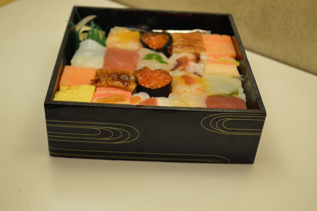 The box of sushi, unwrapped
