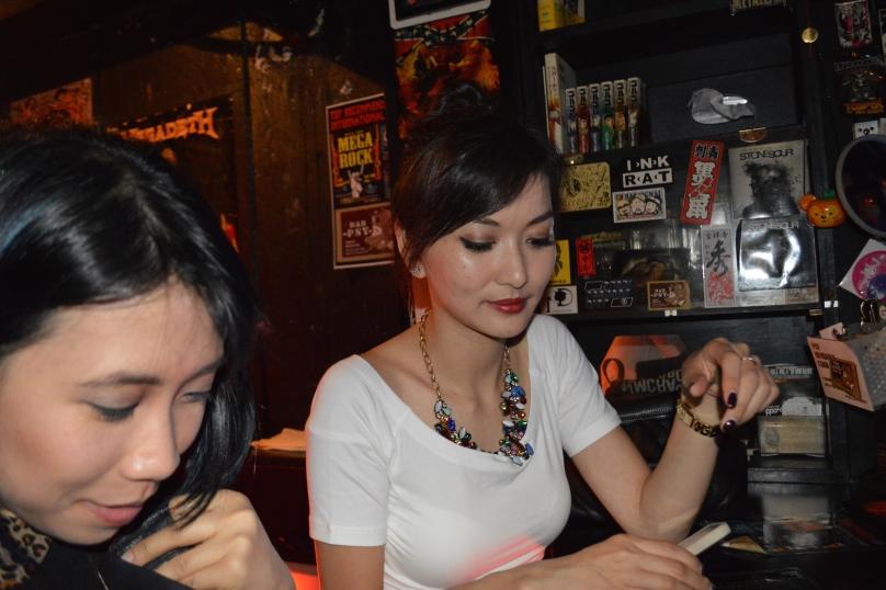 A and J perusing the bar menu