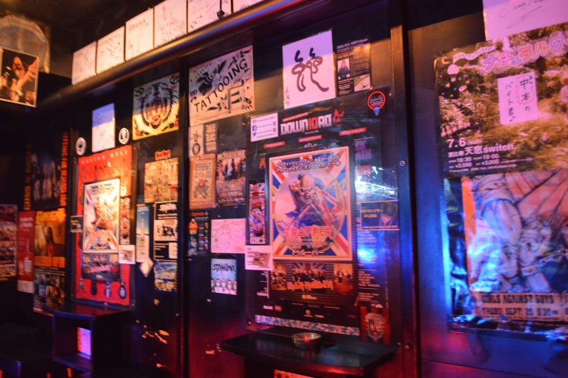 Posters on the wall of the bar