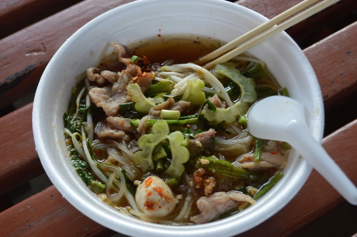 The finished noodle soup, topped with bitter melon slices