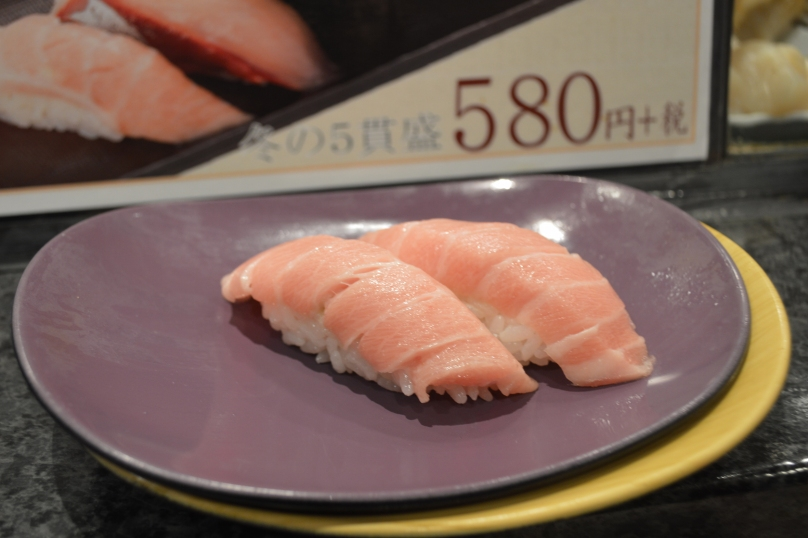 Otoro at a standing sushi bar inside Shinjuku station