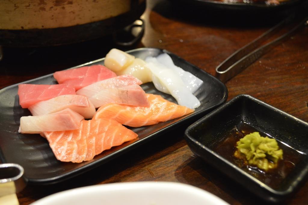 Salmon, tuna, kingfish and squid sashimi